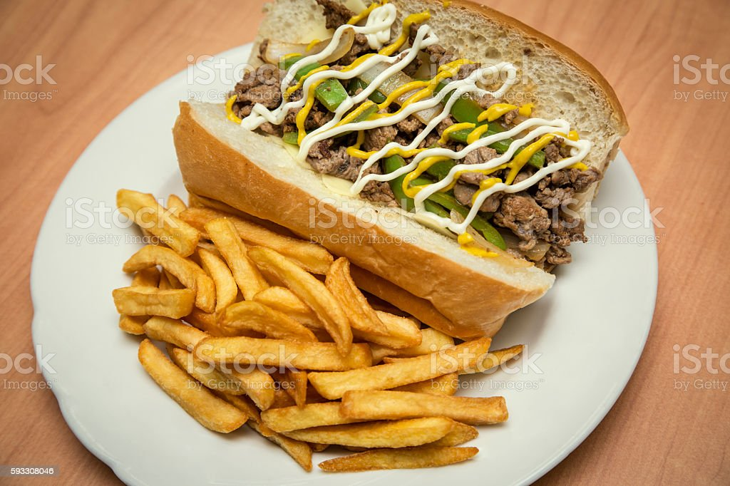 Steak sandwich with french fries stock photo