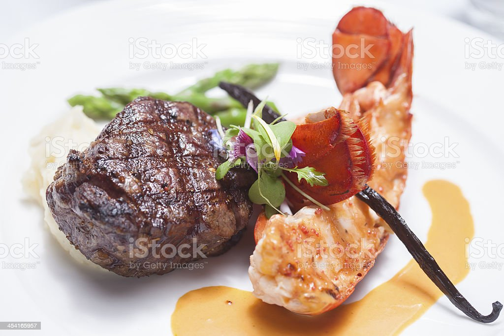 Steak, shrimp and asparagus with sauce on plate royalty-free stock photo