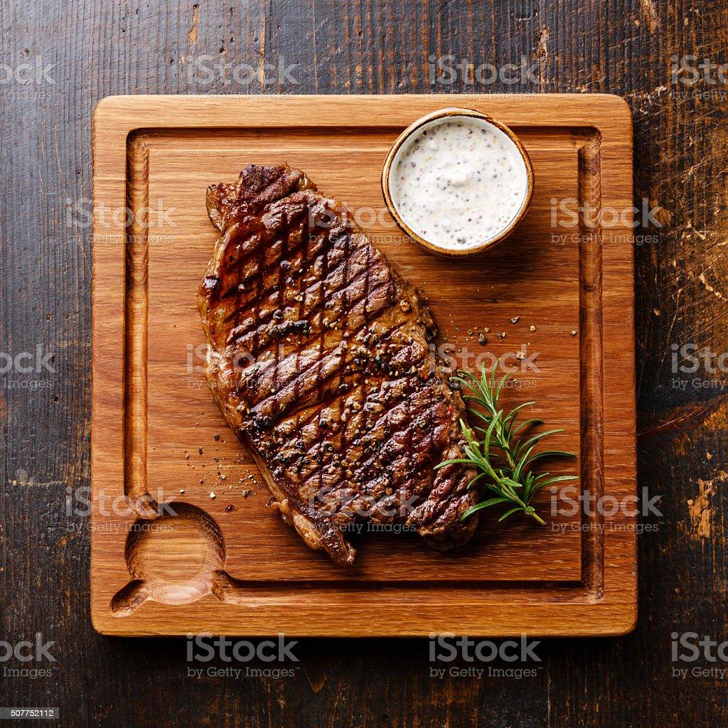 Steak Striploin and Pepper sauce stock photo