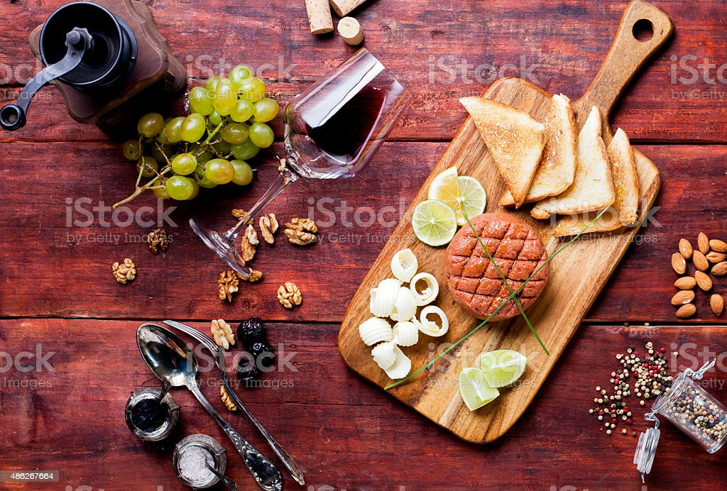 Steak tartare served on wooden board stock photo