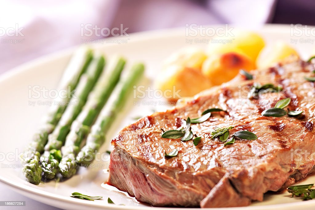 Steak with asparagus and potateos royalty-free stock photo
