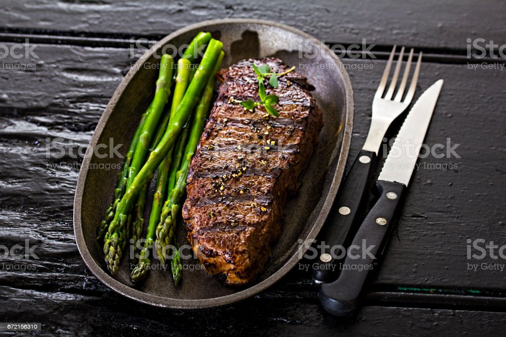 Steak with asparagus stock photo