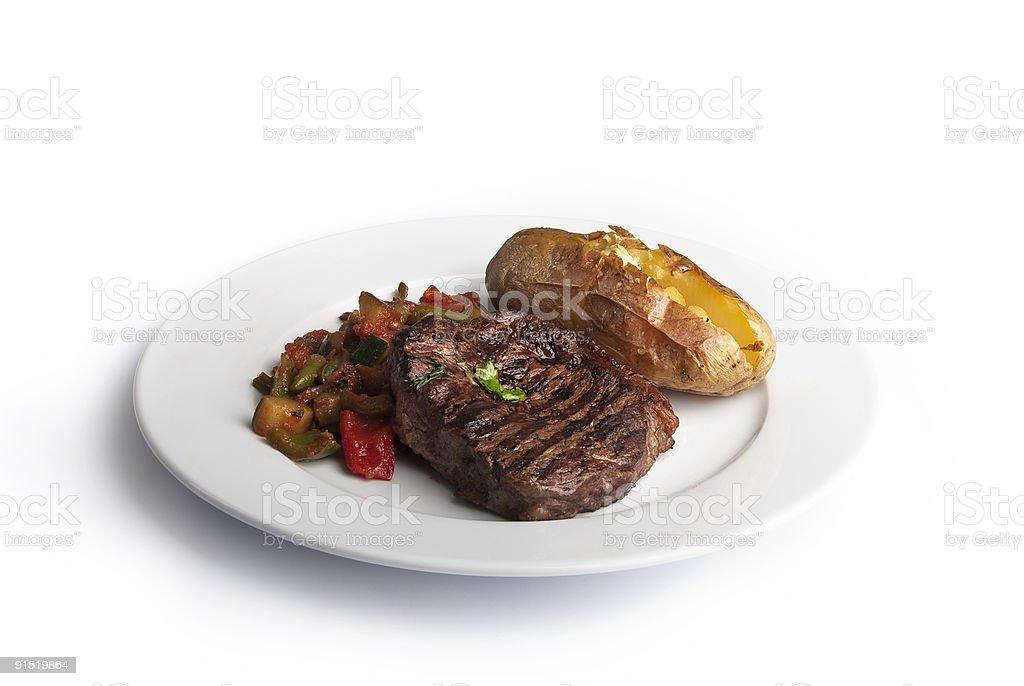 Steak with baked potato stock photo