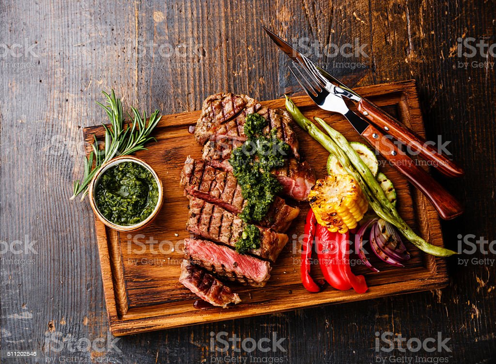 Steak with chimichurri sauce and Grilled vegetables stock photo