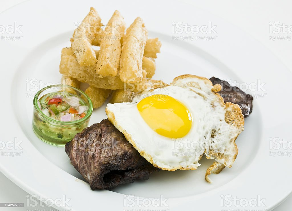 Steak with fried egg and yucca royalty-free stock photo