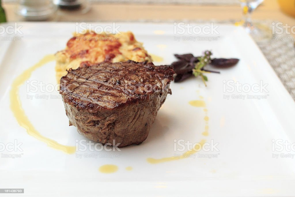 Steak with gratin on a plate royalty-free stock photo