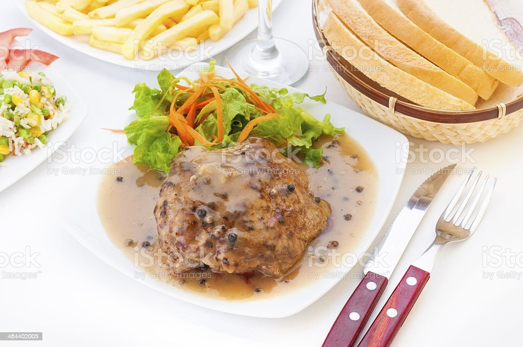 Steak with green pepper sauce stock photo