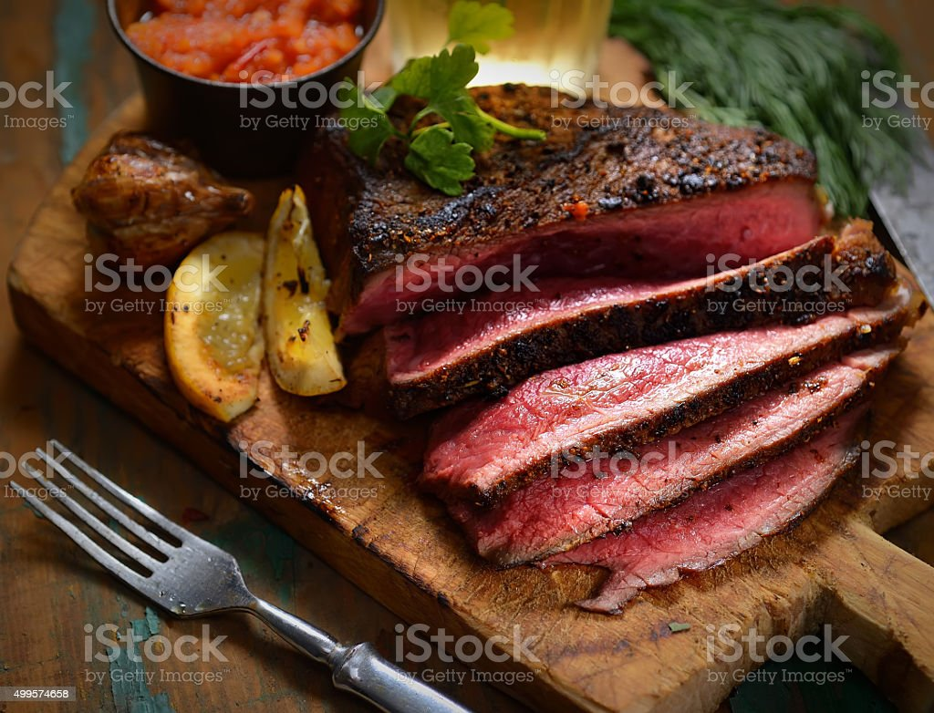Steak with herbs and beer stock photo