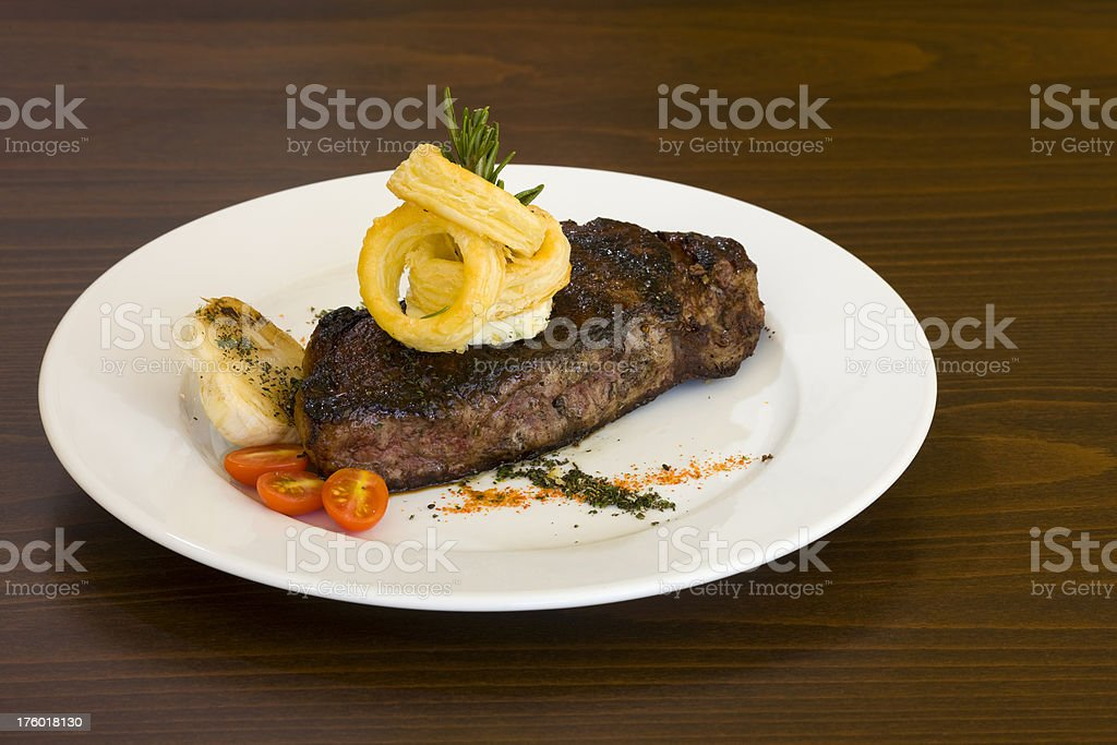 Steak with onion rings royalty-free stock photo