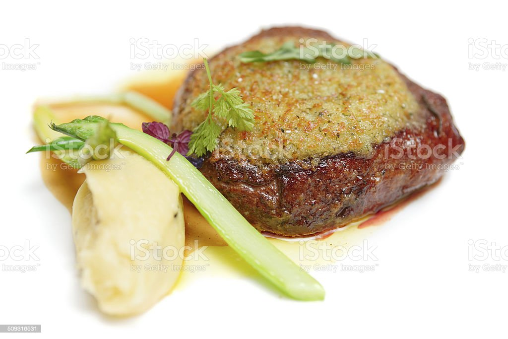 Steak with potato mash in plate isolated on white royalty-free stock photo