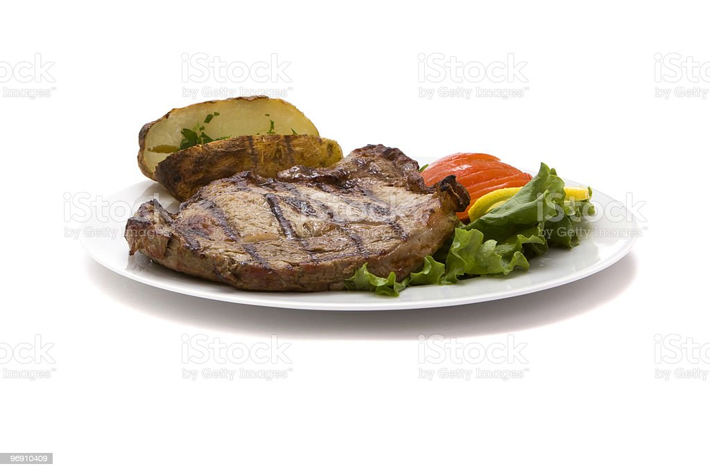 Steak with potatoes and vegetables for dinner royalty-free stock photo
