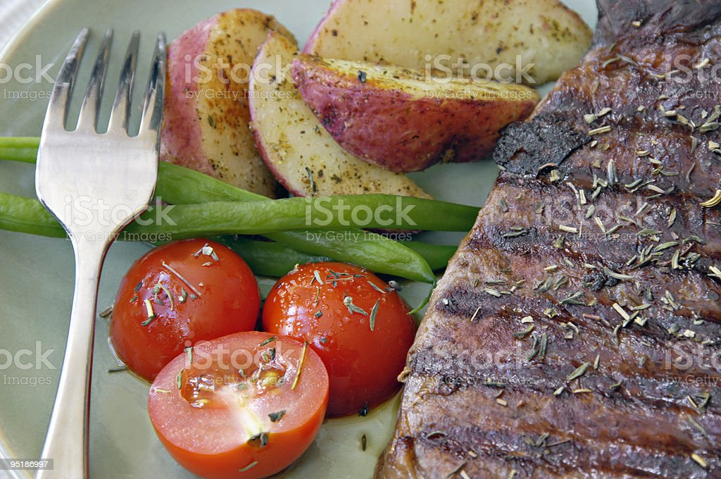 Steak with Potatoes, Tomatoes, and Beans royalty-free stock photo