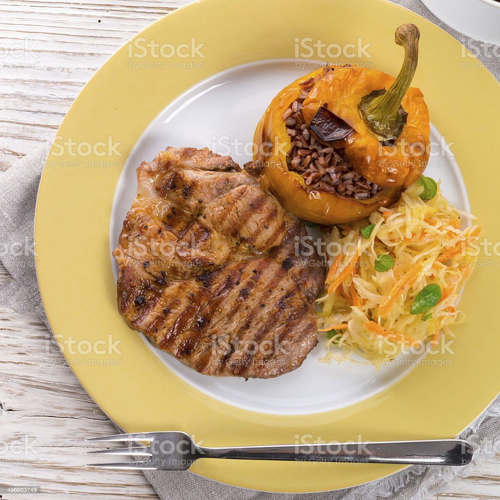 Steak with rice stuffed peppers stock photo