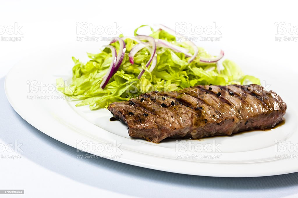 Steak with side salad royalty-free stock photo