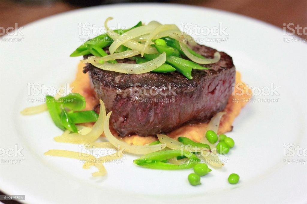 Steak with Snap Peas stock photo