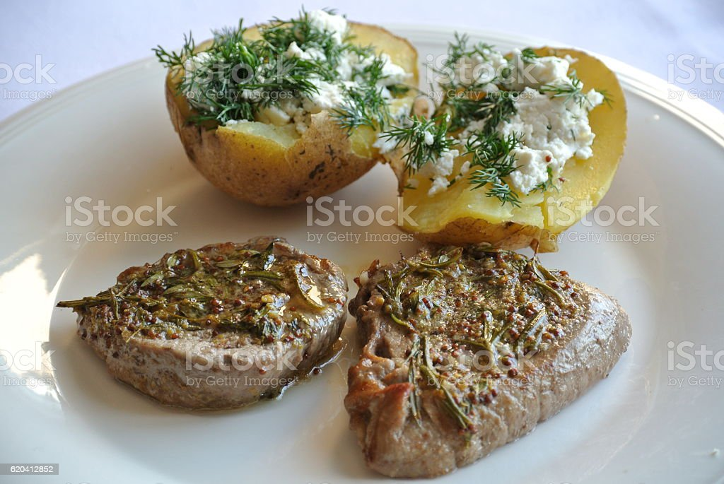 Steak with Stuffed Potato stock photo