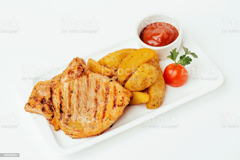 Steak with Tomato Sauce and potatos stock photo