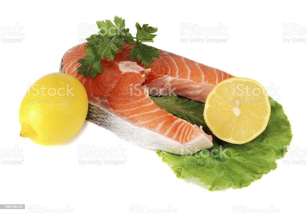 steaks of red fish with a lemon and parsley royalty-free stock photo