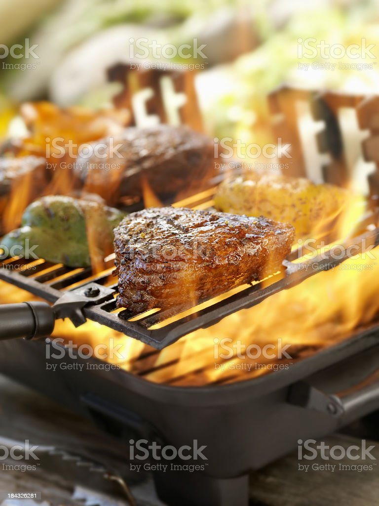 Steaks on a Outdoor BBQ stock photo