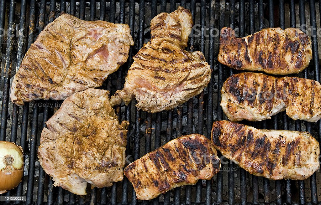 Steaks on Barbeque Grill royalty-free stock photo