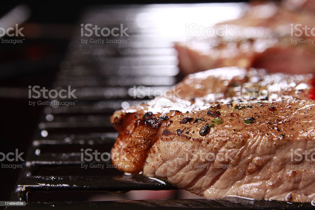 Steaks on the Barbecue Grill royalty-free stock photo
