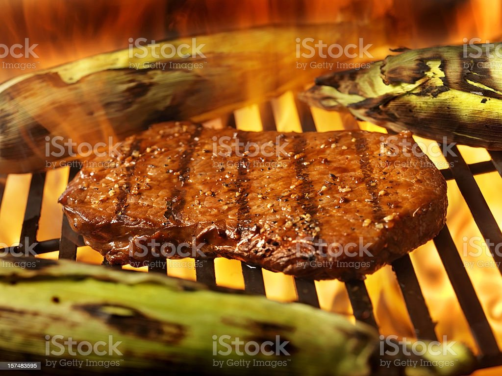 Steaks on the BBQ with Corn royalty-free stock photo
