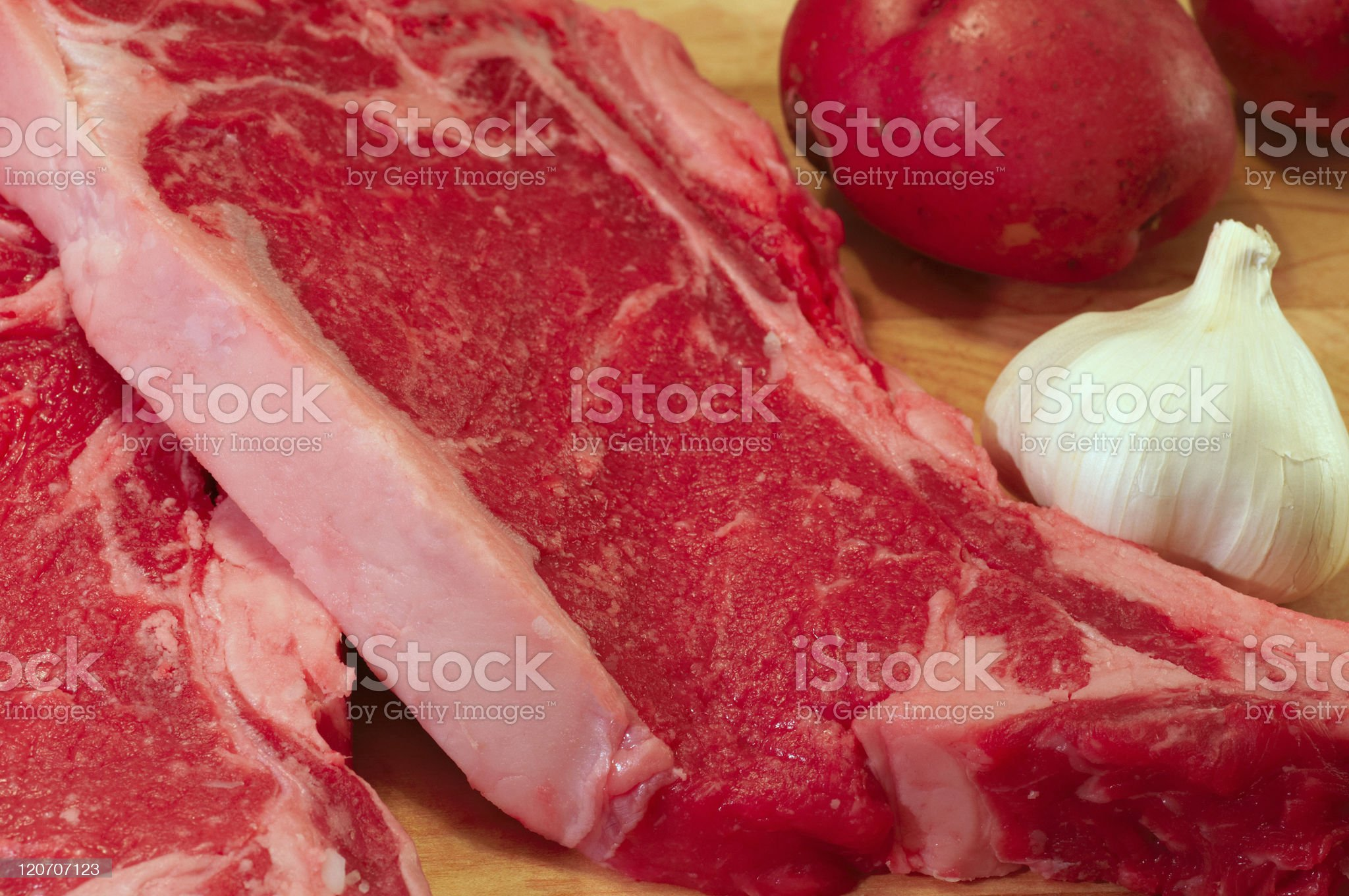 Steaks, potatoes, and garlic royalty-free stock photo