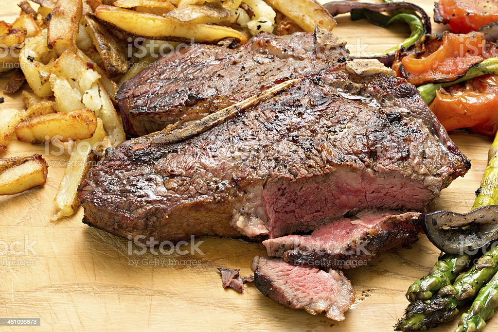 Steak,Vegetables And Fries stock photo