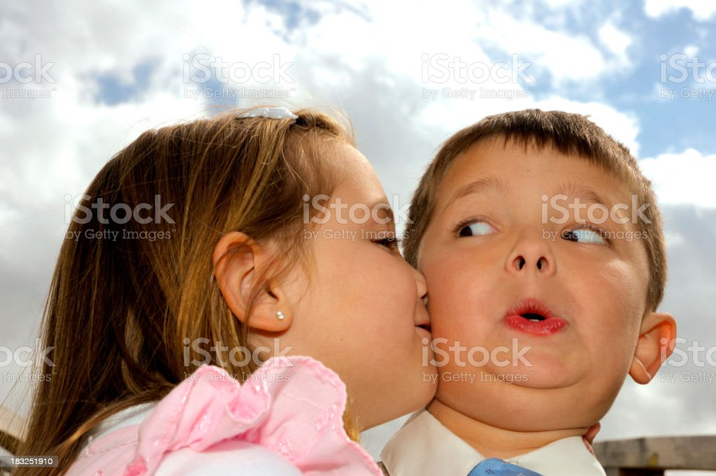 Stealing a Kiss royalty-free stock photo