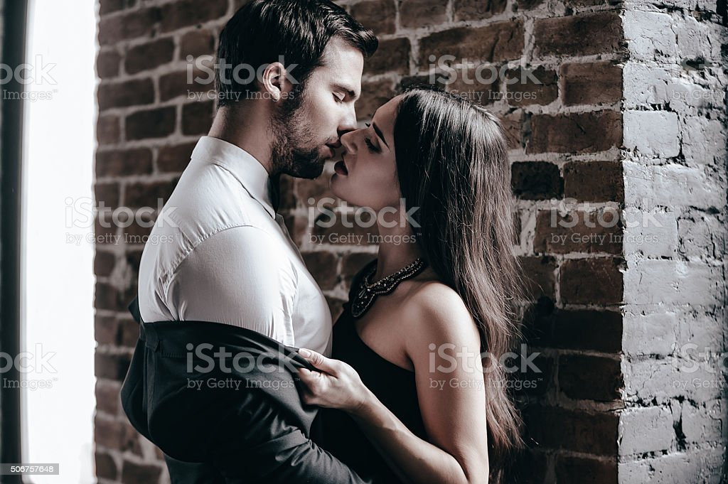 Stealing a kiss. stock photo