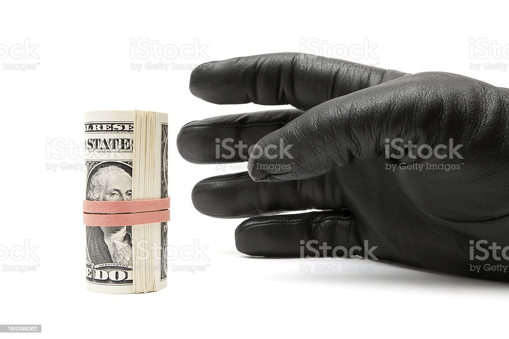 Stealing a Money Roll royalty-free stock photo