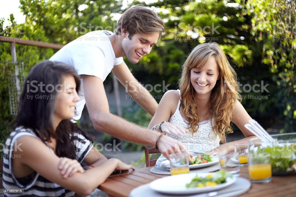 Stealing a piece of her lunch royalty-free stock photo
