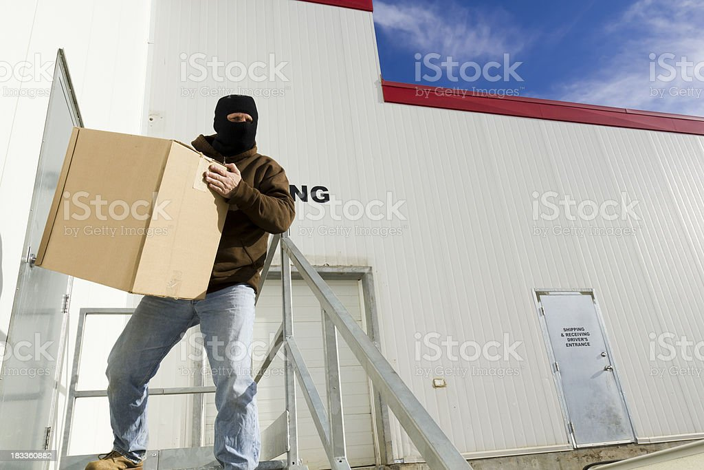 Stealing from a Warehouse stock photo