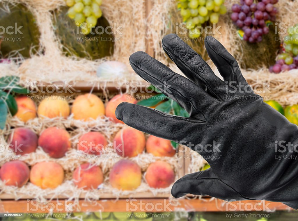 stealing from the greengrocer stock photo