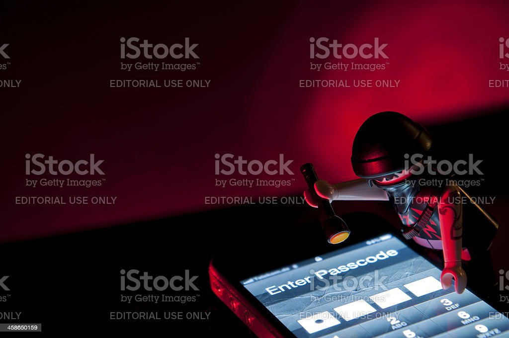 Stealing information from a Smartphone royalty-free stock photo