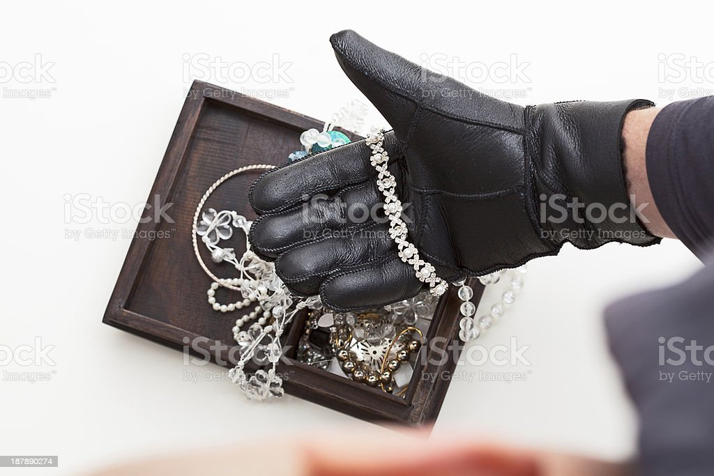 Stealing jewellery royalty-free stock photo
