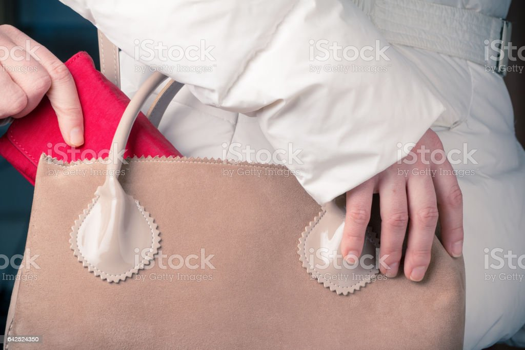 stealing red wallets stock photo