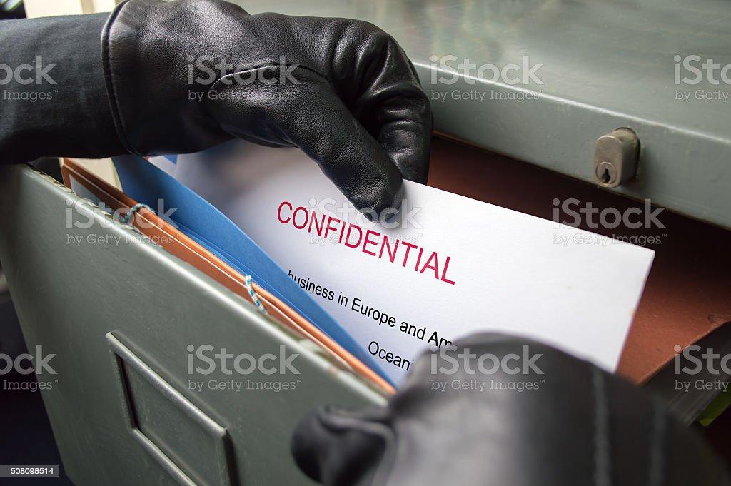 stealing secrets documents stock photo