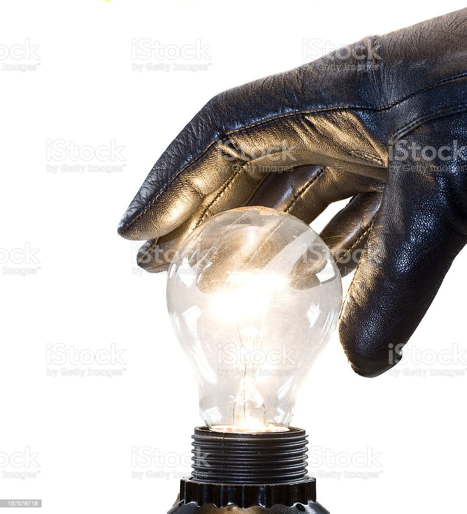 stealing the idea with black gloves and bulb - Ideenklau royalty-free stock photo