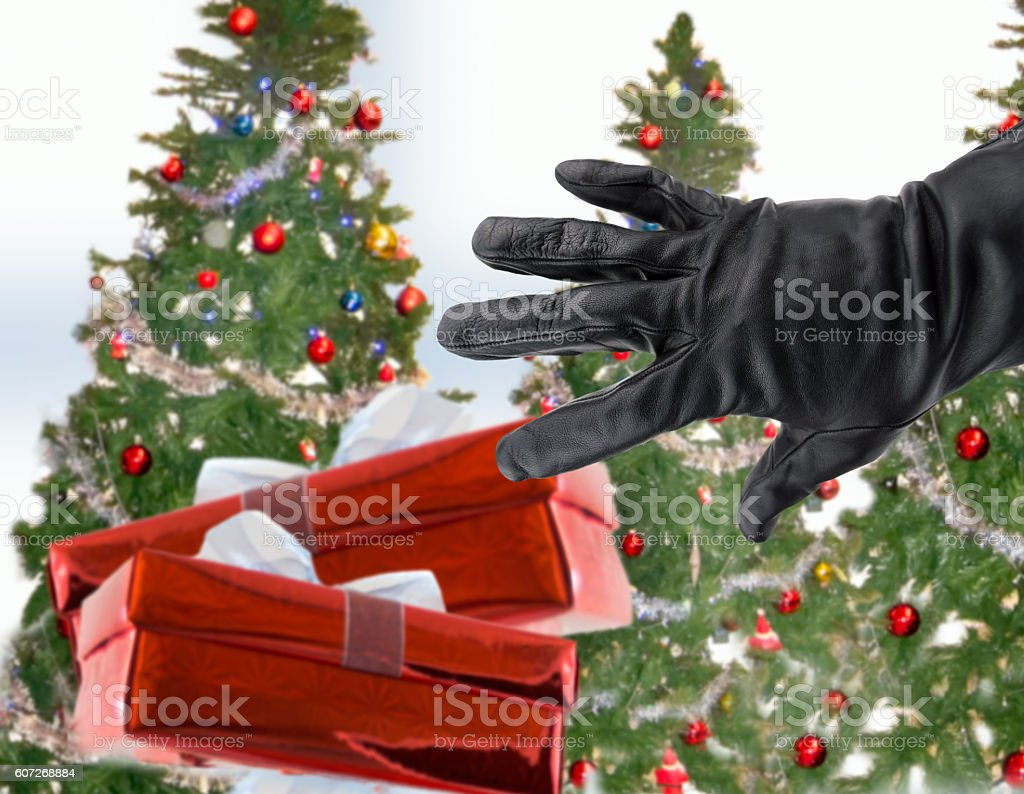 stealing xmas gifts stock photo