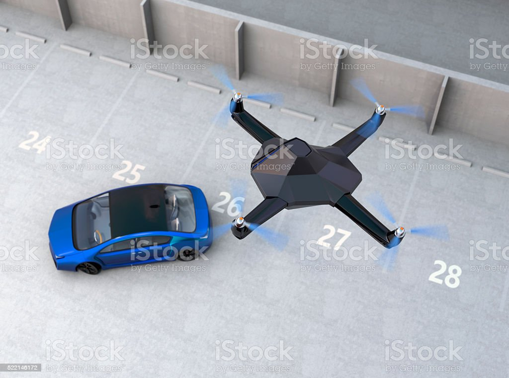 Stealth drone following a car in the sky stock photo