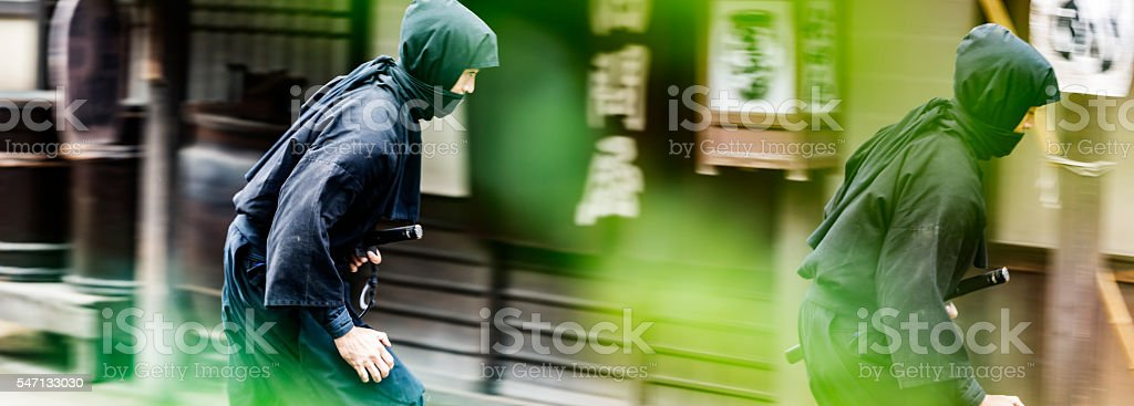 Stealthy Japanese Ninjas Sneaking Through a Traditional Village stock photo