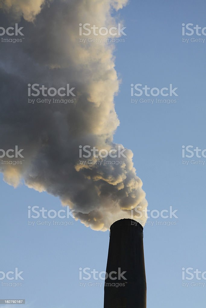 Steam Belching Out Of A Factories Smokestack stock photo