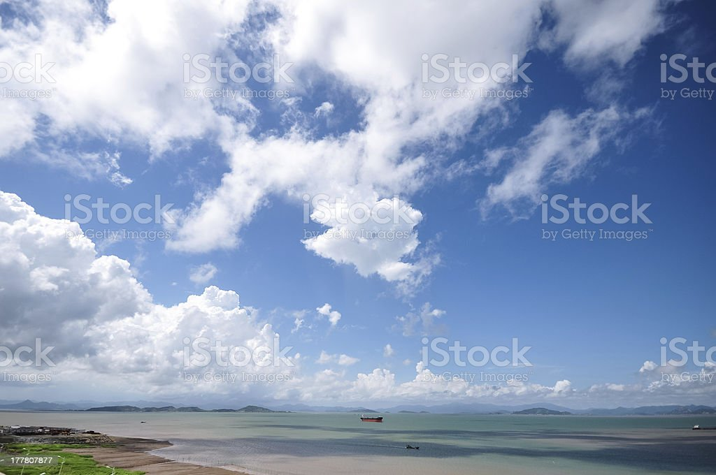 steam boat on the sea in cloudy day royalty-free stock photo