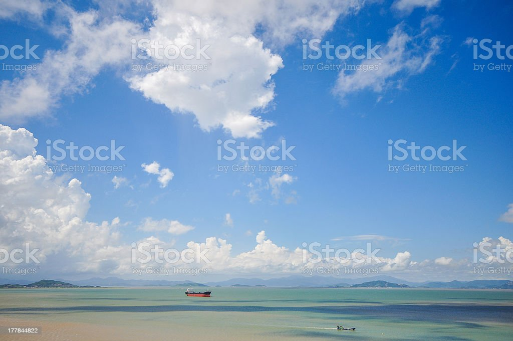 steam boat sailing on sea under the sky royalty-free stock photo