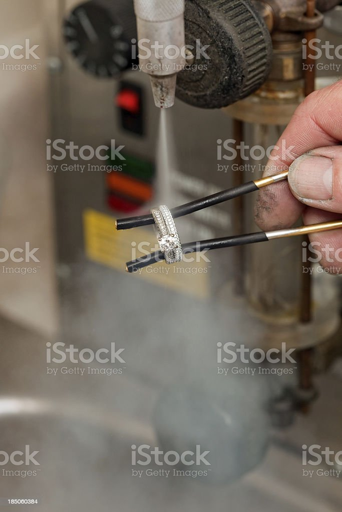 Steam Cleaning Diamond Wedding Ring royalty-free stock photo