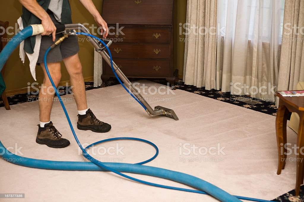 Steam Cleaning the Living Room royalty-free stock photo