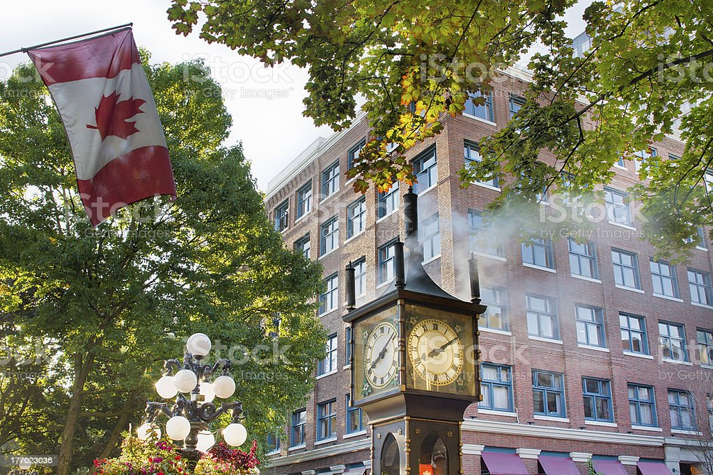 Steam Clock at Gastown with Canadian Flag stock photo