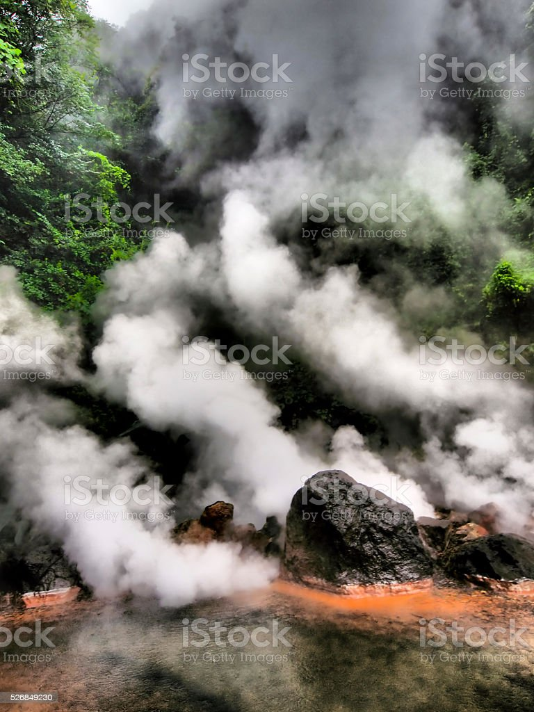 Steam coming out of volcanic graund stock photo