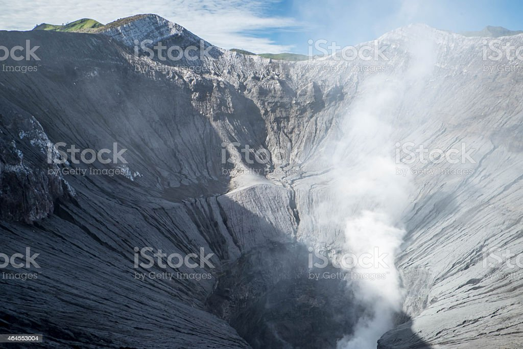 Steam emerging from Mount Bromo crater stock photo